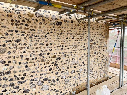 Tower walls: Extensive repointing works with lime mortar