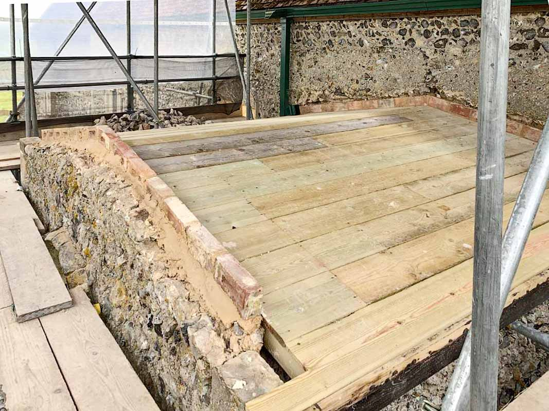 Porch Roof: Structural works complete and sarking deck reinstated. Rebuilding of loose masonry in parapet underway